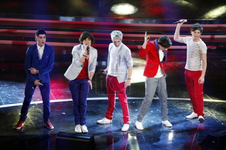 Photo for One Direction perform on stage at the fourth day of the 62th Sanremo Song Festival at the Ariston Theatre on February 17, 2012 in SANREMO, Italy. - Royalty Free Image