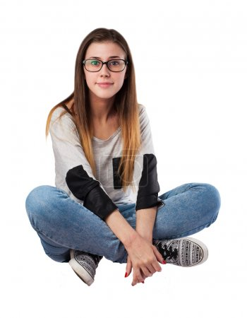 Photo for Young woman sitting on the floor isolated - Royalty Free Image