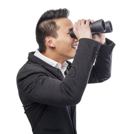 Photo for Handsome young asian man looking trough binoculars - Royalty Free Image