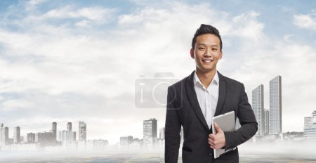 Young asian business man using his tablet