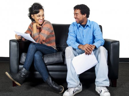 Two actors waiting at a casting call with scripts...