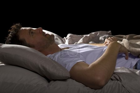 Insomniac unable to sleep in bed
