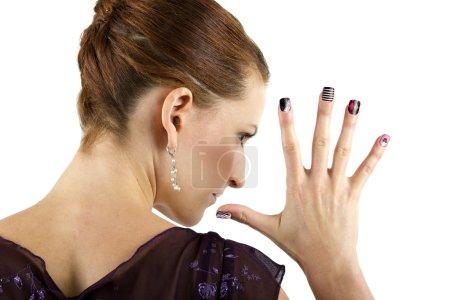 Female model showing nail art