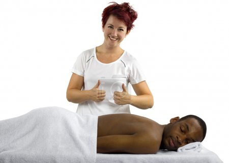 Female masseuse treating male client