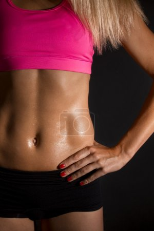 Sweaty female abdominal muscles