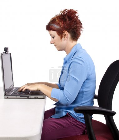 Photo for Young woman demonstrating office desk posture - Royalty Free Image