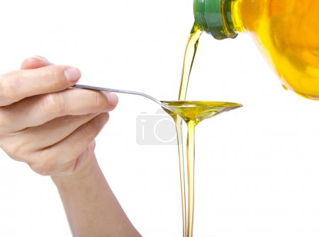 Woman pouring oil