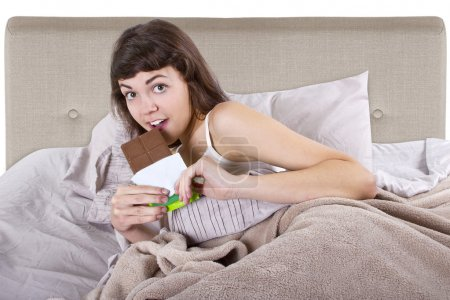 Girl eating junk food before going to bed