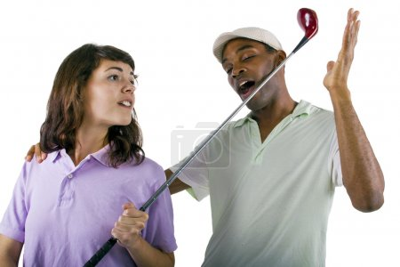 Golf instructor with a teenager student