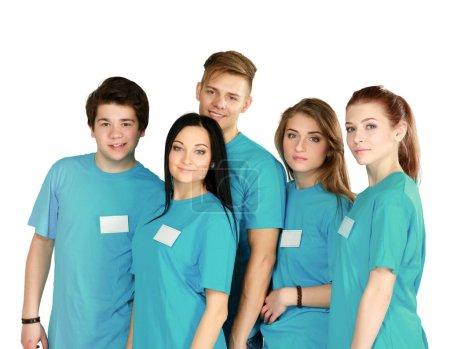 Foto de Grupo grande de amigos sonriendo de pie juntos aislado sobre fondo blanco - Imagen libre de derechos
