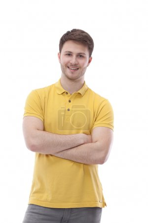 Young man standing with folded arms, isolated on white background