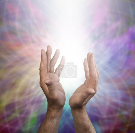 Photo for Male Healer with outstretched hands and rainbow matrix energy formation - Royalty Free Image