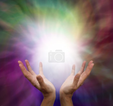 Photo for Female healer with outstretched hands and energy on a muted color background with energy light ball - Royalty Free Image