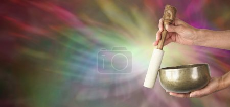 Photo for Woman holding tibetan singing bowl with muted colors in background and sound waves effect - Royalty Free Image