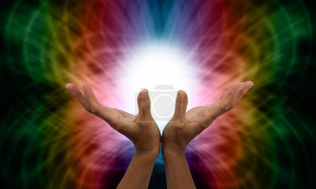 Photo for Healer's outstretched open hands with ball of white light between on a rainbow colored web-like energy formation background - Royalty Free Image