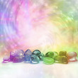 Selection of rainbow colored crystals on a rainbow...