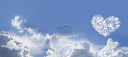 Blue Sky and Love Heart Shaped fluffy clouds