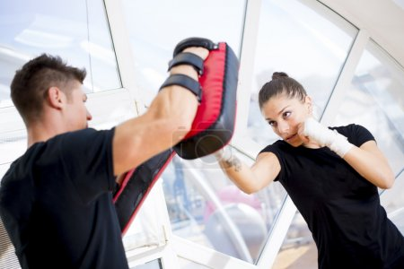 Photo for Couple exercise punching in a gym - Royalty Free Image