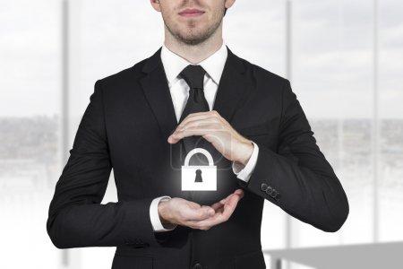 Businessman protecting lock symbol