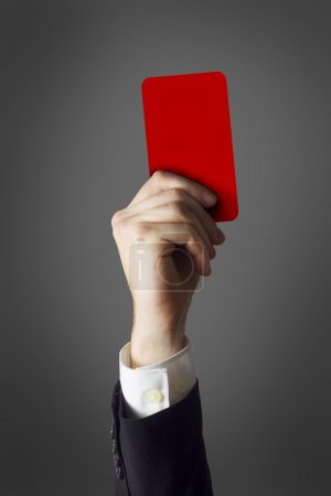 businessman showing red card