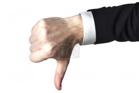 Photo pour Homme d'affaires de suite noir montre les pouces vers le bas - image libre de droit