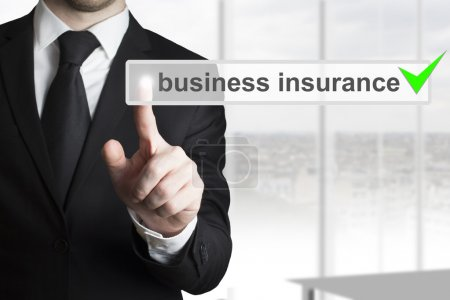 Businessman pushing button business insurance