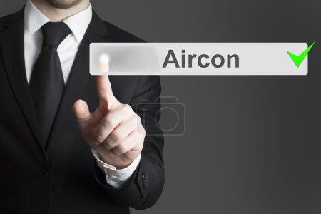 Businessman pushing button aircon automatic checke...