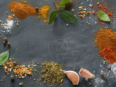 Photo for Assorted spices on blackboard background, selective focus - Royalty Free Image