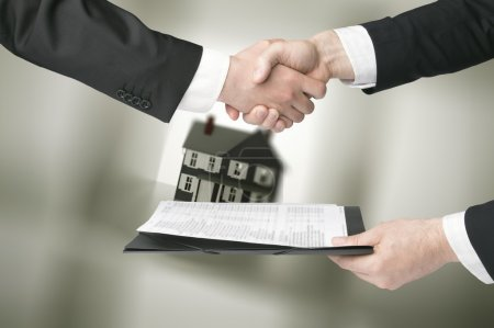 Photo for People shaking hands in a real estate transaction - Royalty Free Image