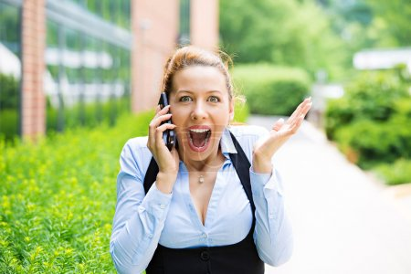 Surprised business woman on a phone