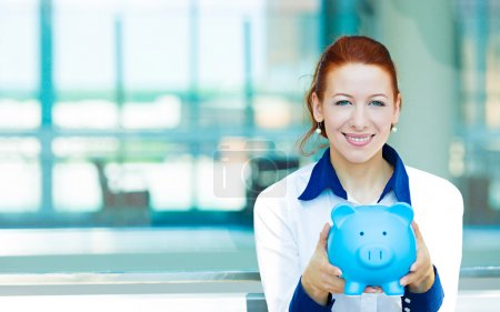 Business woman holding piggy bank