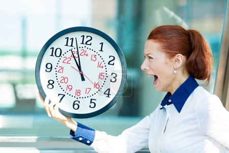 Photo for Closeup portrait business woman being late with clock in hands. Concept photo with young businesswoman in hurry running against time, isolated background  corporate office windows. Face expression - Royalty Free Image