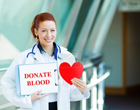 Blood banker holding donate blood sign