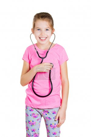 Little girl listenig  to her heart with stethoscope