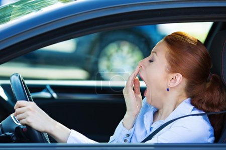 Sleepy fatigued driver, driving car