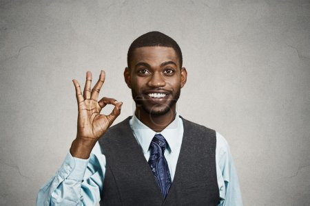 Photo for Closeup portrait young handsome, happy, smiling, excited man, corporate employee, worker giving OK sign with fingers, isolated black grey background. Positive human emotion facial expressions, symbol - Royalty Free Image