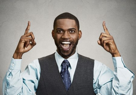 Excited businessman pointing with fingers up