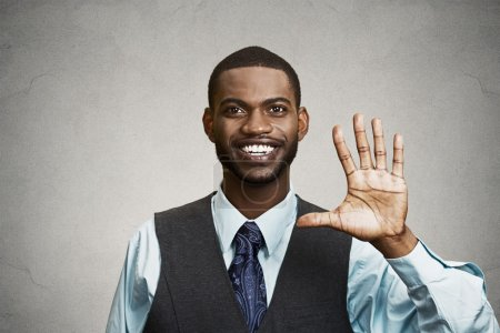 Happy man giving five times gesture with hand