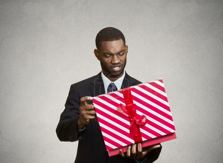 Unhappy man, displeased with new gift