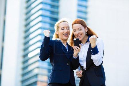 Portrait happy business women, arms raised up, par...