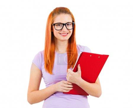 Happy female student holding books