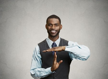 Executive man giving time out gesture with hands