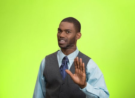 Photo for Closeup portrait furious angry annoyed displeased young man raising hands up to say no stop right there isolated green background. Negative human emotion facial expression sign symbol body language - Royalty Free Image