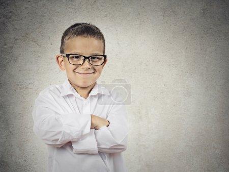 Happy confident little boy, small man