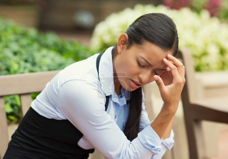 Photo for Closeup portrait unhappy business woman head on hand sitting on park bench bothered by mistake having bad headache isolated background outdoor office. Negative human emotion, facial expression feeling - Royalty Free Image
