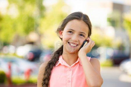 Happy girl talking on mobile, smart phone