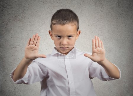 Boy giving stop gesture with hands