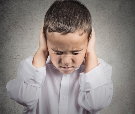 Boy Covers his Ears, hear no evil concept