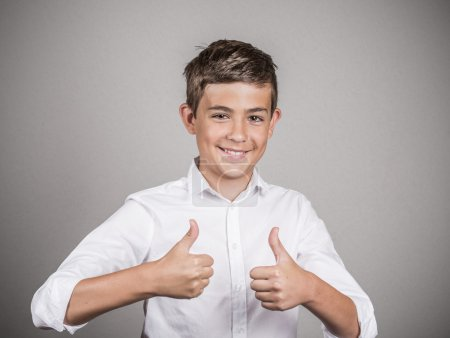 Teenager giving thumbs up gesture