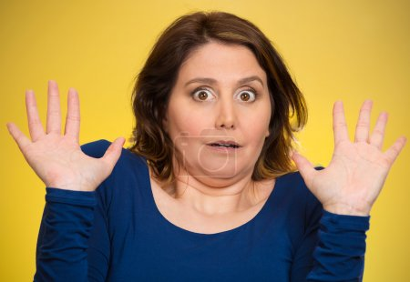 Shocked scared middle aged woman